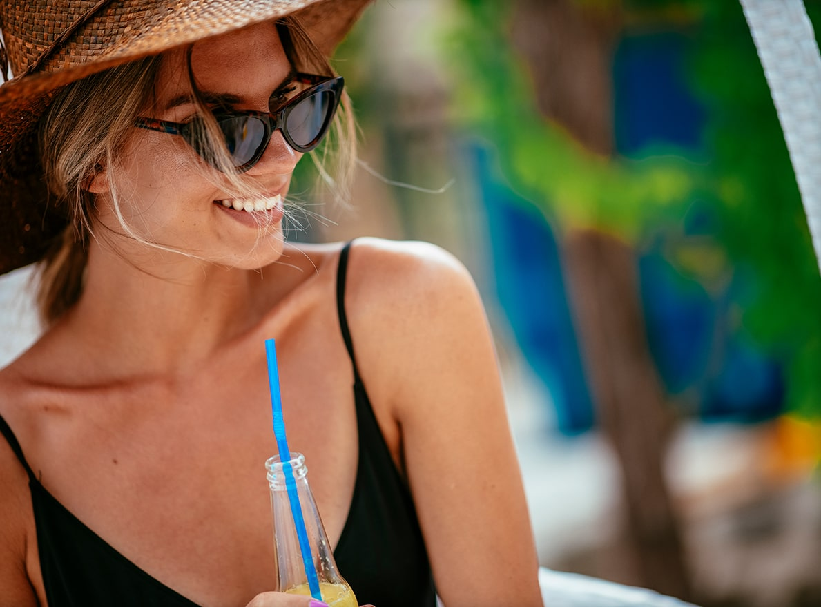woman in straw hat smiling at Bayso