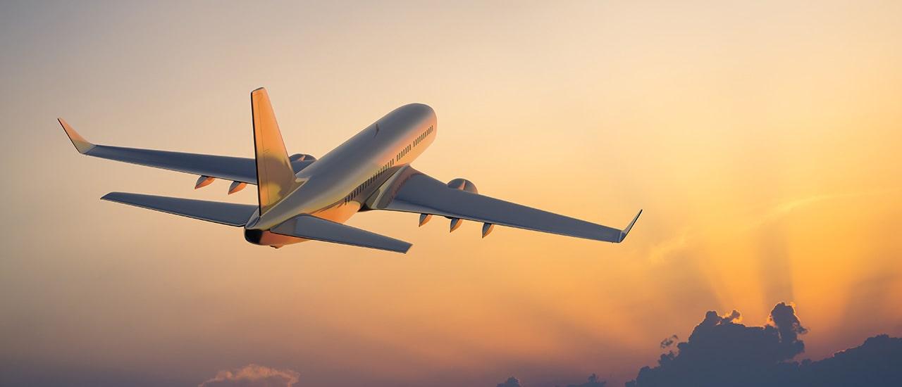 plane flying with orange skies to sarasota international airport